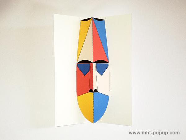 Carte pop-up Masque d'Afrique, modèle beige-rouge, vue de dessus. Format allongé