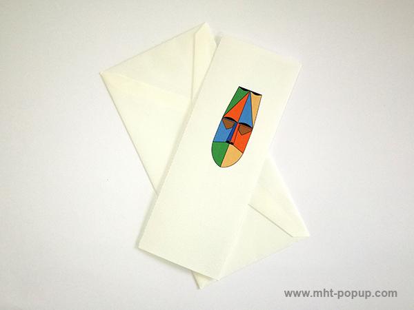 Carte pop-up Masque d'Afrique, modèle orange-bleu, carte avec enveloppe. Format allongé