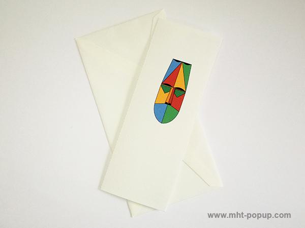 Carte pop-up Masque d'Afrique, modèle rouge-jaune, carte avec enveloppe. Format allongé