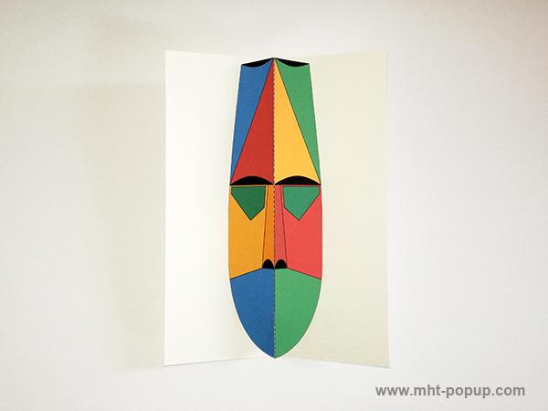 Carte pop-up Masque d'Afrique, modèle rouge-jaune, vue de dessus. Format allongé