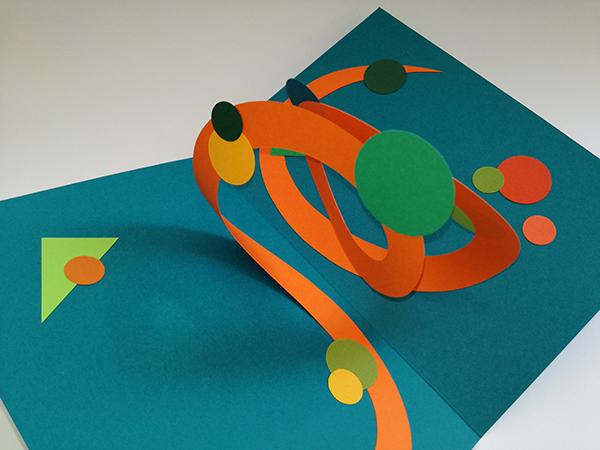 Carte pop-up Spirale motifs abstraits, riviera blue-orange, vue de dessus. Pièce unique signée