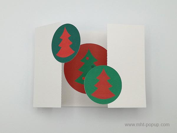 Carte de vœux à volets, vue de dessus carte ouverte sapins rouges sur fond vert et motif central inversé variante 2