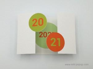 Carte de vœux à volets 2021, orange-vert, carte ouverte avec motif central vert pistache