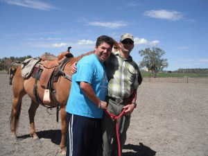 Hank thanks an attendee for his help with the special needs horseback ride.