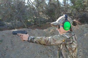 The Little Gal shooting a Beretta .40 cal. Wearing Altus Brands ReVO ProEars.