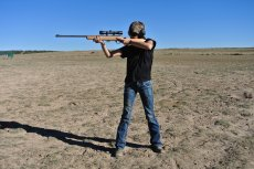 Standing shooting position provides support from arms only.