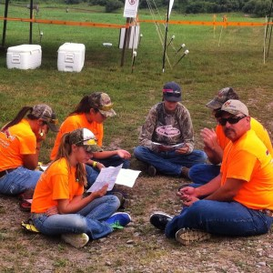 LG and her new New Mexico friends study their hunting licenses before the Hunter Safety trail course.