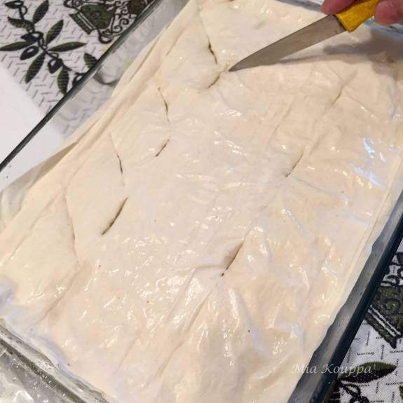 Scoring the phyllo dough before baking