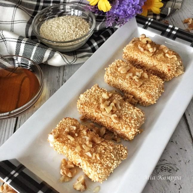 Sesame coated fried feta with honey and walnuts