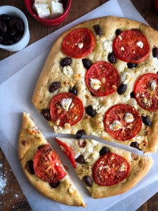 Focaccia with tomatoes, olives and feta