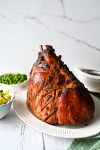 A maple, brown sugar and Dijon glazed ham served with a pineapple salsa