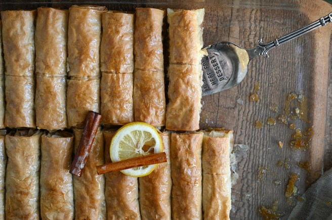 Saragli or Baklava cigars are a traditional Greek syrup soaked dessert make with phyllo dough and nuts
