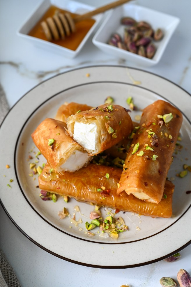 Fried phyllo wrapped feta with chili flakes, honey and crushed pistachios.
