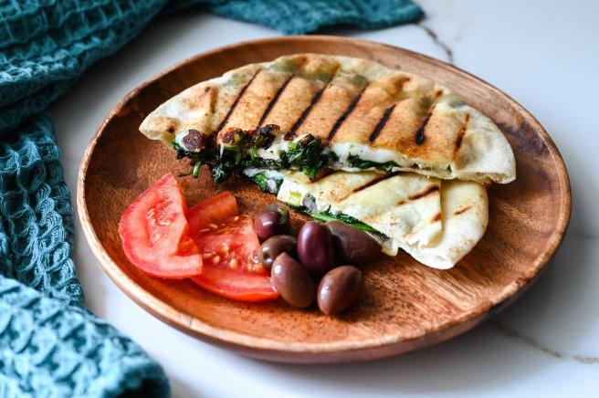 Spinach and cheese pita pocket full of spinach, feta and mozzarella.