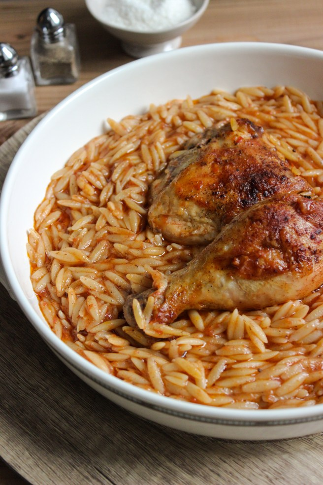 Youvetsi with chicken in pure comfort food. Tender chicken and wonderful orzo baked in a rich tomato based sauce.