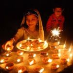 Decorating the house with lights for Diwali