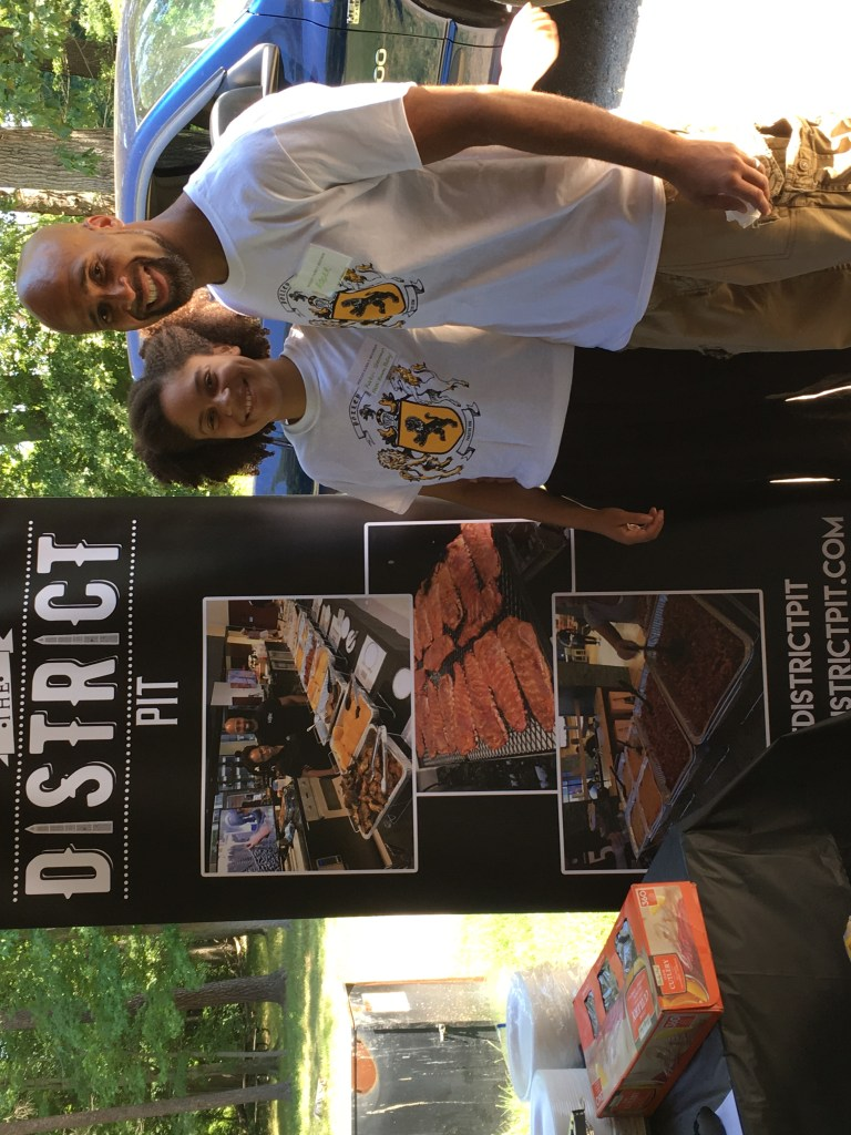 Miamian Roger Sherman '01 (right) with his daughter Katiri. He and his family founded his catering business, District Pit, in 2016 as he started thinking of ways to pay for his daughters' education.