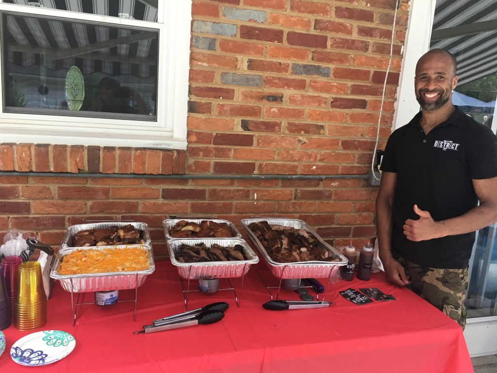 Miamian Roger Sherman '01 founded his catering business District Pit in 2016 as he started exploring ways to pay for his daughters' college educations.
