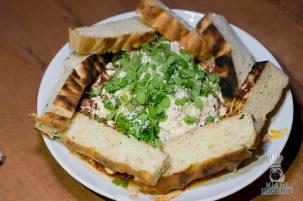 Swank Table - Farm Market Dinner - Lamb Shashouka by Boulud Sud