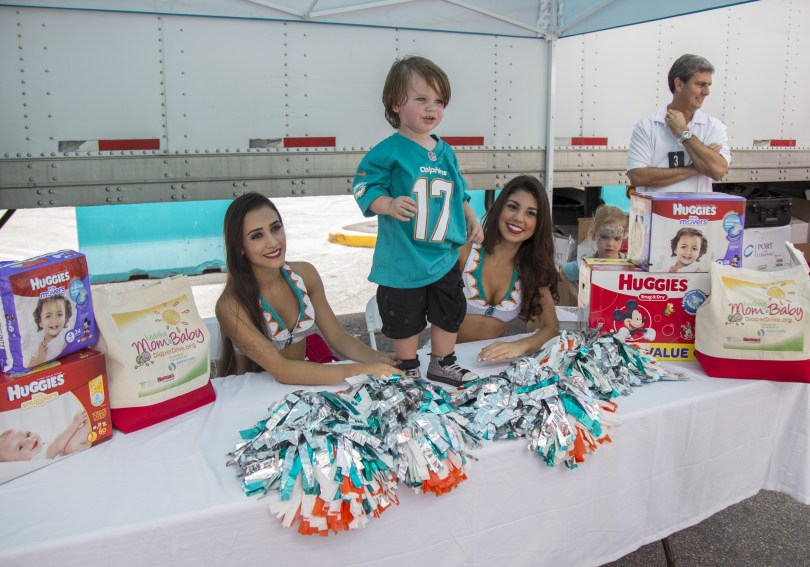Miami Dolphins cheerleaders get into the spirit of giving to the Huggies No Baby Unhugged Diaper Drive at Hard Rock Stadium. on Sunday, Sept. 25, 2016 in Miami Gardens, Fla. (Jesus Aranguren/AP Images for Huggies)