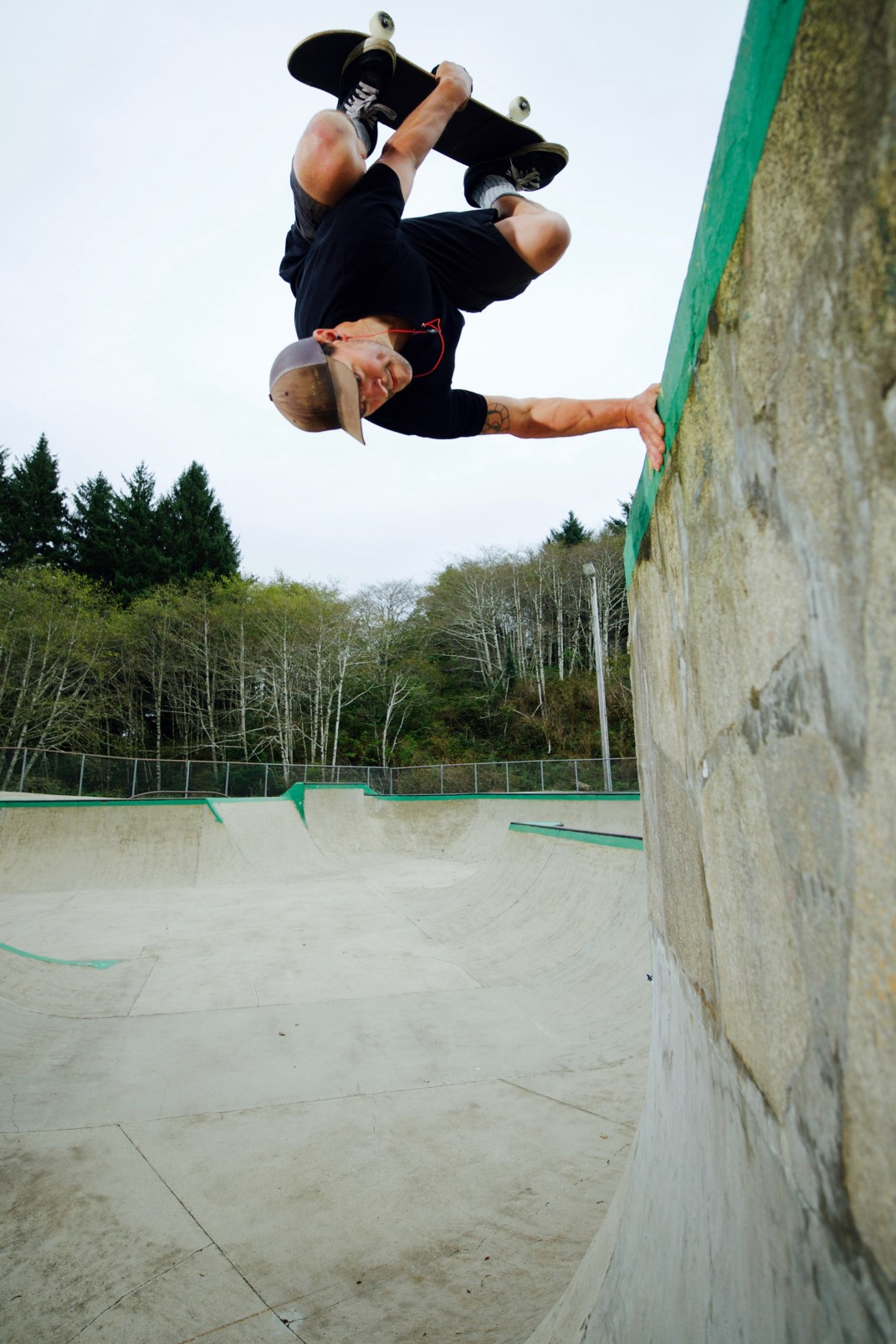"""Mark """"Red"""" Scott planting one on the tombstone at Lincoln City"""