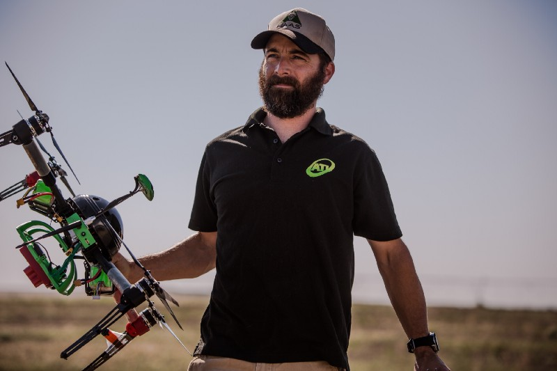 Service provider carrying a drone equipped with the MicaSense RedEdge