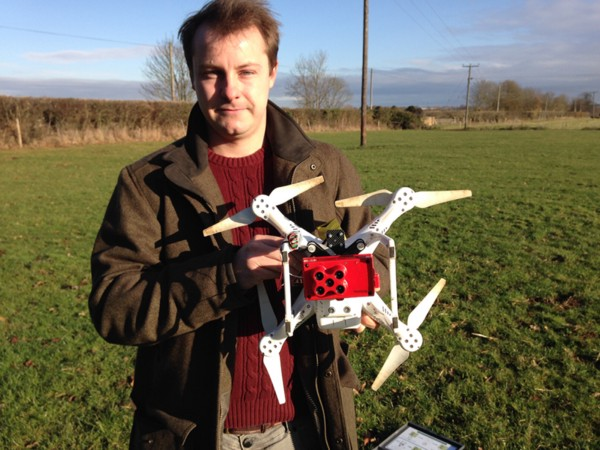 Henry Webber holds the drone and the RedEdge multispectral sensor