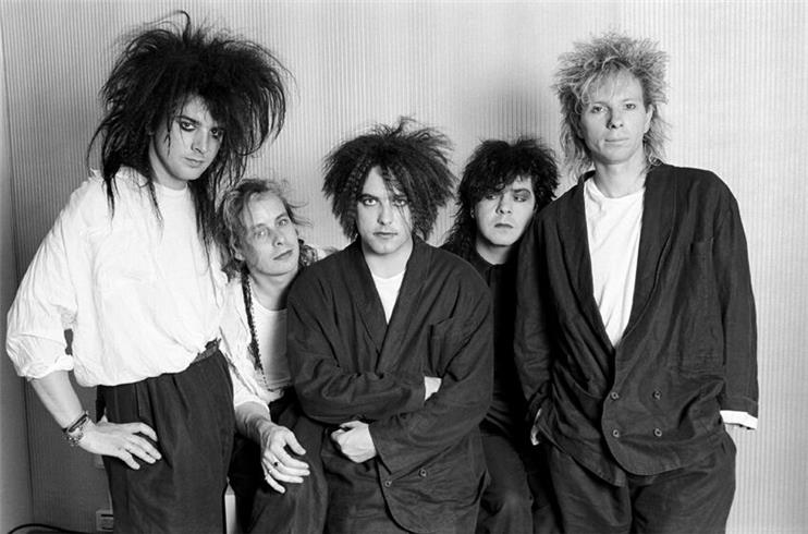 A picture of the members of The Cure from the 80s.
