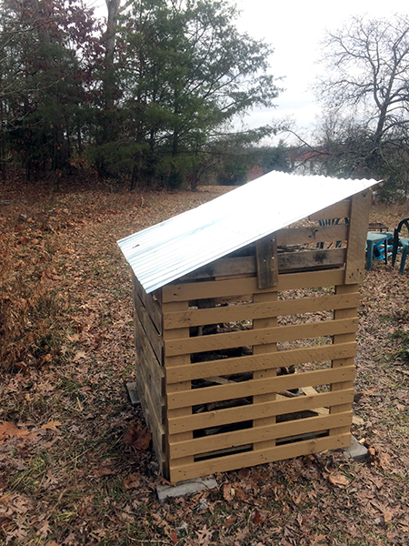 Recycled pallet wood shed, side view