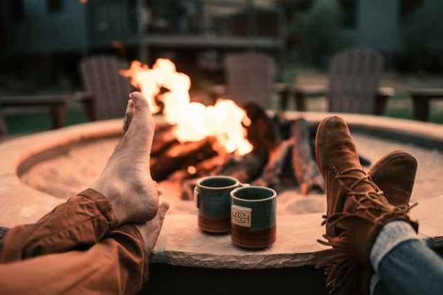 people s feet near mugs