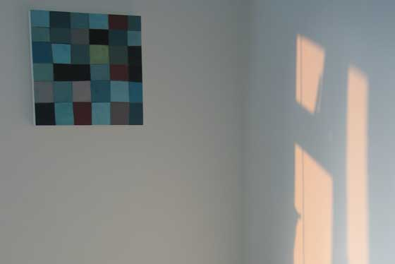 sunlight on the wall with a painting by Michaela French