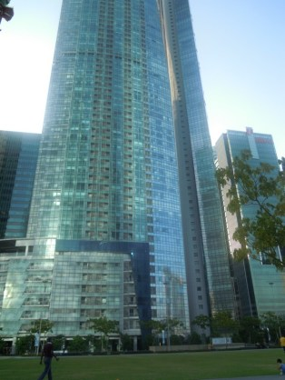 Many of these steel and glass buildings. Notice in the lower part of the buildng is the reflection of the Marina Bay Sands
