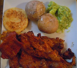 Plate of Chigüire, arepa, potatoes and guacamole