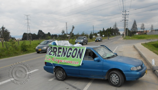 vehicle selling Merengon on side of road