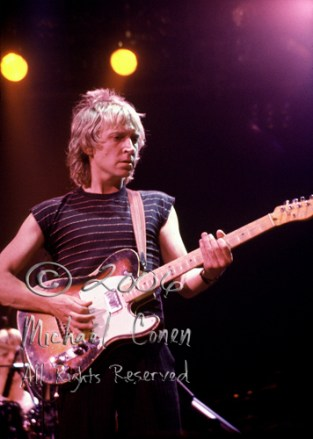 """Andy Summers in a well-lit moment. One of the few frames where you can """"just"""" spot Stewart Copeland in the background"""