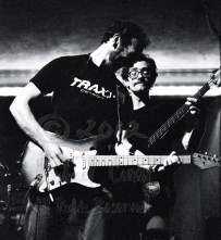 Mr. Thompson solos, and grins, while Pete Zorn continues on bass guitar