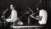"""Townes Van Zandt, Danny """"Ruester"""" Rowland behind the mic stand, and Owen Cody on the fiddle"""