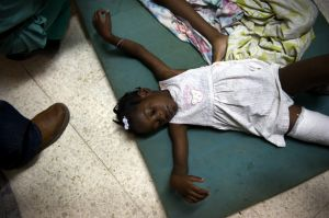 Injured girl on floor