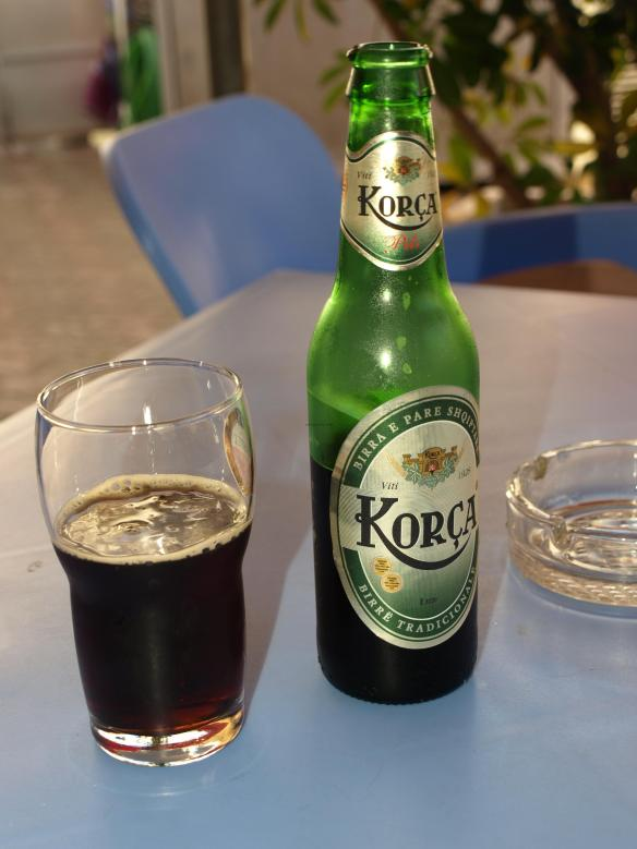 Korça Beer bottle with a glass half full!