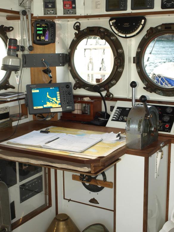 Inside the wheelhouse of a tall ship