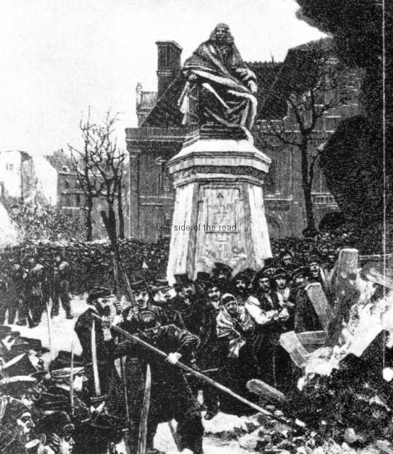 Burning the Guillotine in front of Voltaire's statue