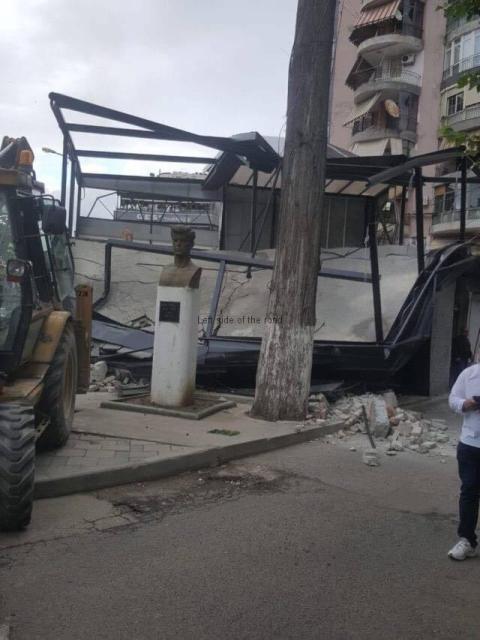 Vojo Kushi amongst the debris