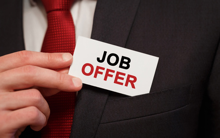 Businessman putting a card with text Job offer in the pocket