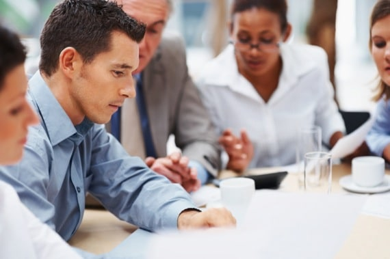 A Group of Business People in a Meeting - Photo courtesy of ©iStockphoto.com/Yuri_Arcurs, Image #12479982