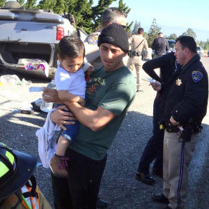 Photograph courtesy of Stephanie Stuehler Los Gatos CrossFit instructor Greg Pena rescued three young accident victims who were dangling from their car seats following a March 26 car wreck. Pena was able to cut them loose before the CHP and other first responders arrived on the scene.