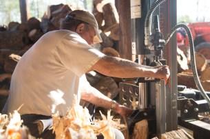 Wood DocumRichard Kinard splits wood before selling it at his wood shed.entary