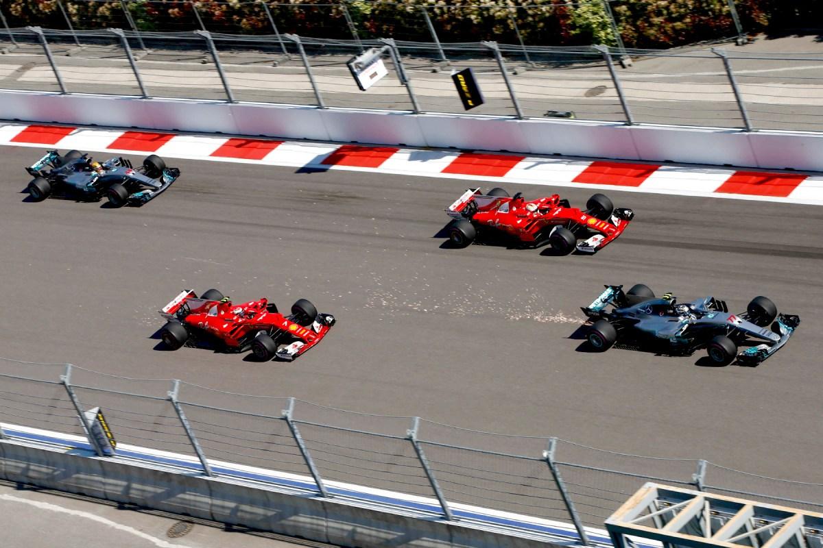 Valtteri Bottas puts his Ferrari ahead of Sebastian Vettel's Ferrari on the first lap of the 2017 Russian Grand Prix.