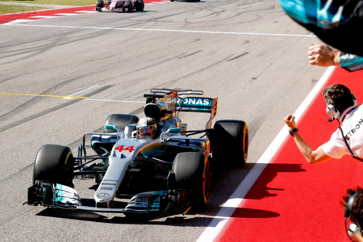Lewis Hamilton takes the chequered flag at the 2017 united States Grand Prix.