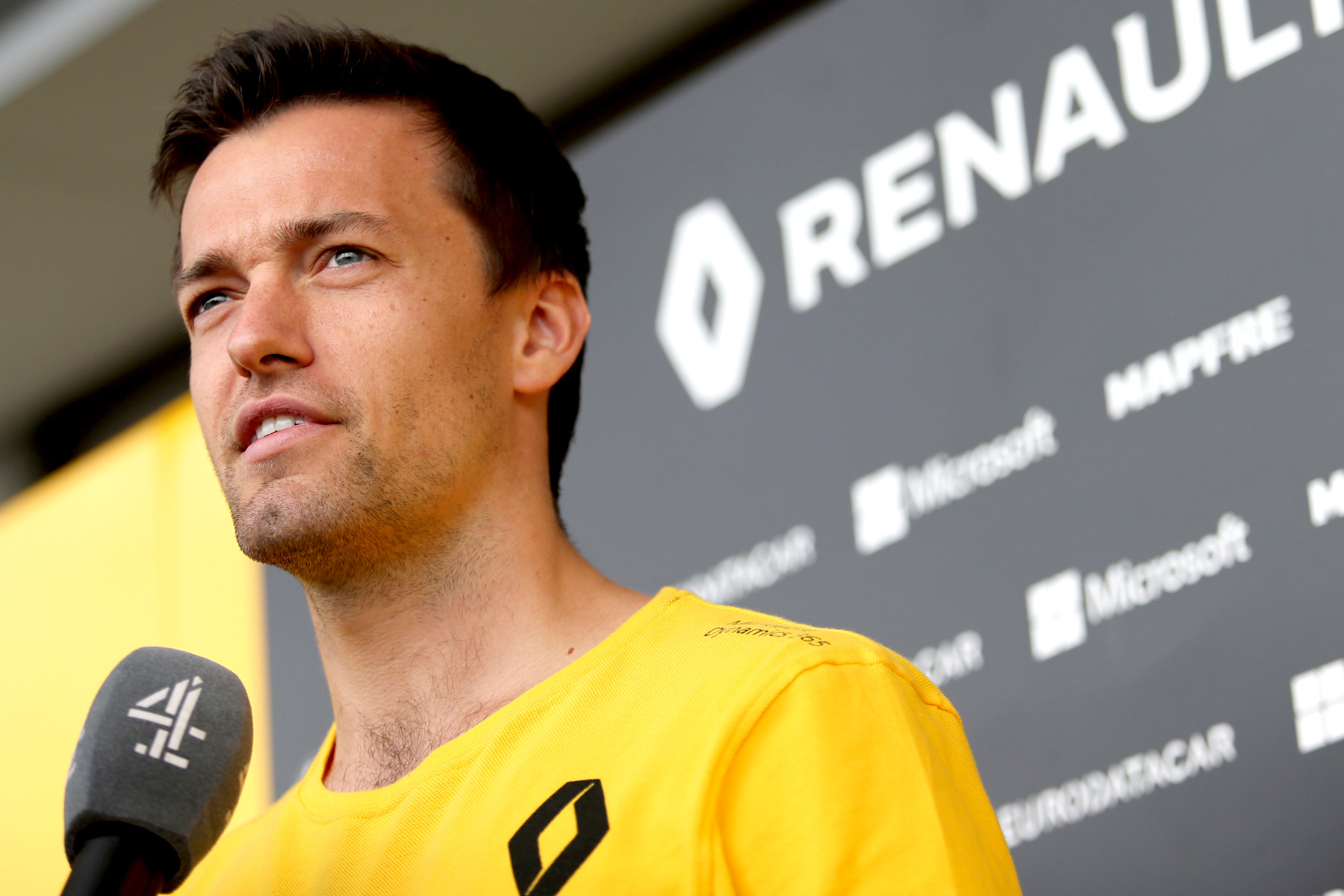 Jolyon Palmer speaks to reporters at the 2017 Japanese Grand Prix.