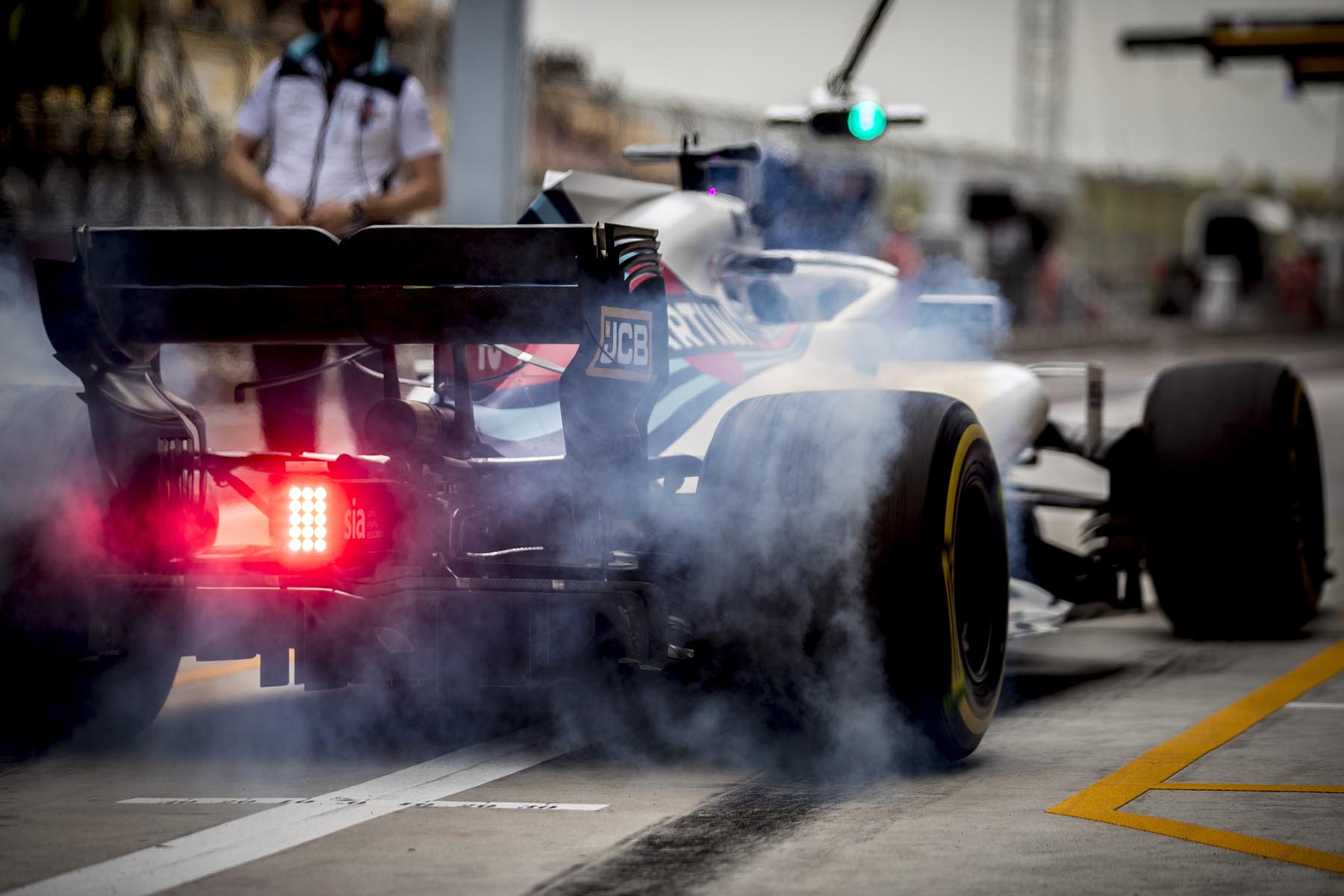 Lance Stroll pulls away from his pit box at the 2018 Chinese Grand Prix.